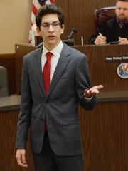 Ray High School student Carlos Carroll, competing as an attorney for the prosecution, gives his opening statement Saturday, Feb. 4, 2017, during the Region 2 high school mock trial competition at the Nueces County Courthouse.