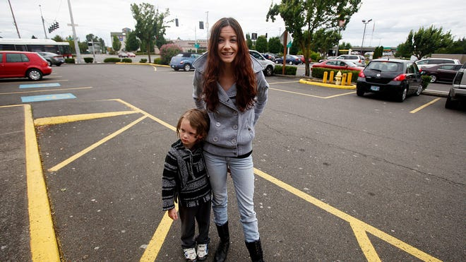 Jessica Ojeda, 23, stands with her 4-year-old son Jack in a parking lot near Market and Hawthorne. In February, her fiancé was arrested for a DUI in this area. Police impounded his car, and she, a passenger, was left there with no money for a taxi and a cellphone that was dead. Her son was not with her at the time.