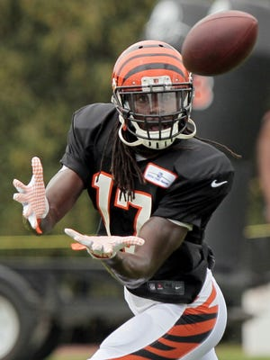 Cincinnati Bengals wide receiver Denarius Moore (17) makes a catch during practice at the Bengals training facility next to Paul Brown Stadium in downtown Cincinnati on Monday, Aug. 17, 2015.