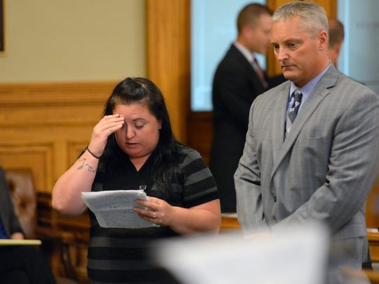 Sarah Ellena, fiance of murder victim Jordan Rogers, reads a statement before Ricard Taylor is sentenced to life in prison without parole Wednesday.