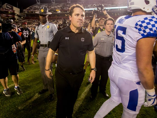 South Carolina coach Will Muschamp leaves the field after his team lost to Kentucky in 2017.