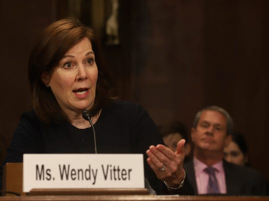 Wendy Vitter, President Donald Trump's nominee to be a District Court Judge for the Eastern District of Louisiana, gives testimony during a U. S. Senate Judiciary Committee Hearing last year on Capitol Hill in Washington on Wednesday, April 11, 2018. At right, listening, is her husband, former Senator David Vitter. (AP Photo/Harry Hamburg)