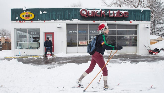 Kelly Zweifel walks to work down College Avenue on a pair of cross-country skis on Wednesday, February 1, 2018 in Fort Collins, Colorado. Parts of Northern Colorado received up to five inches of snow in the storm.