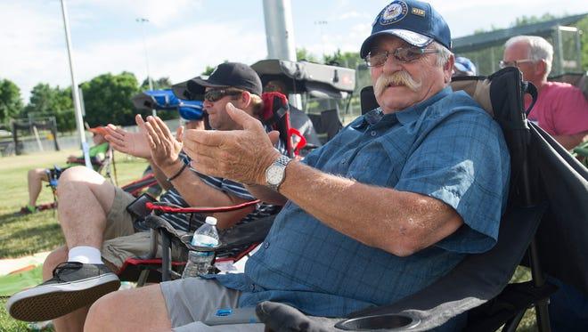Gene Gorham cheers during his grandson's baseball game at Edora Park on Thursday, June 7, 2018.