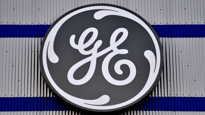 (FILES) In this file photo taken on November 21, 2016 the logo of US company General Electric is seen at a factory of the group,  in Montoir-de-Bretagne, western France.   French Labour Minister Muriel Penicaud said on June 17, 2018 that General Electric will have to pay the penalties following their decision not to keep their commitment in terms of job creation in France.  / AFP PHOTO / LOIC VENANCELOIC VENANCE/AFP/Getty Images ORIG FILE ID: AFP_1634F9
