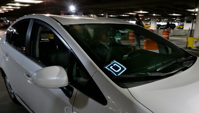 A driver for Uber Technologies Inc., arrives at an authorized customer pick up area at Seattle-Tacoma International Airport, Thursday, March 31, 2016 in Seattle.