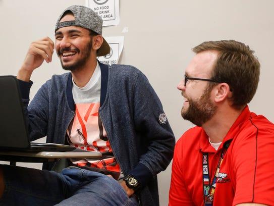Ammar Bukhari, left, laughs with William Bruner, an