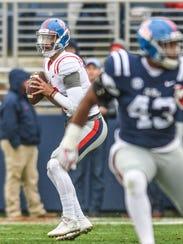 Ole Miss quarterback Jordan Ta'amu (10) looks to pass