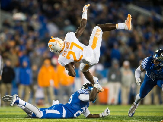 Tennessee running back Carlin Fils-aime (27) is taken down by Kentucky safety Darius West (25) during the Tennessee vs. Kentucky game at Kroger Field in Lexington, Kentucky Saturday, Oct. 28, 2017.