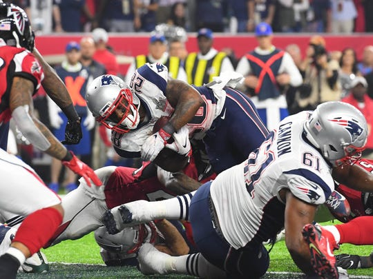 New England Patriots running back James White scores