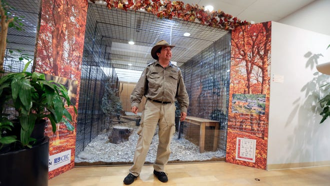 """Ron DeArmond, the dean of the Academy of Wildlife Education, talks about the """"animal ambassadors"""" on display at the exhibit on Thursday, June 26, 2014 at Merle Hay Mall in Des Moines, Iowa."""