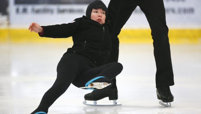 Patti Craze practices her pairs ice skating program with her partner of three years, Doug Johnsen at the Arcadia Ice Arena in Phoenix on January 10, 2014.