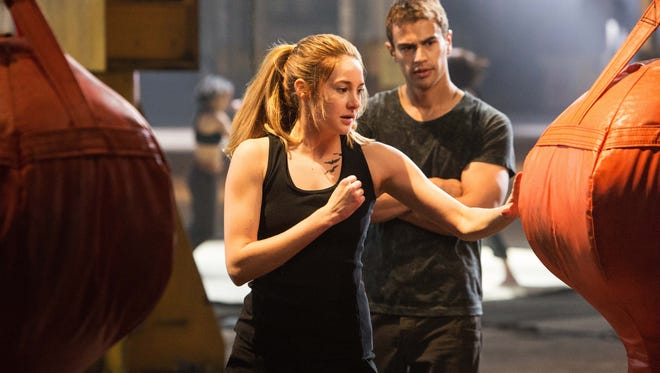 Tris (Shailene Woodley) is coached by Four (Theo James) in a scene from 'Divergent'