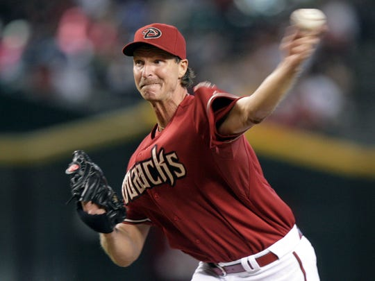FILE - In this April 29, 2007, file photo, Arizona Diamondbacks' Randy Johnson delivers a pitch against the San Francisco Giants in the second inning of a baseball game in Phoenix. Johnson was elected to the National Baseball Hall of Fame on Tursday, Jan. 6, 2015. (AP Photo/Paul Connors, File)