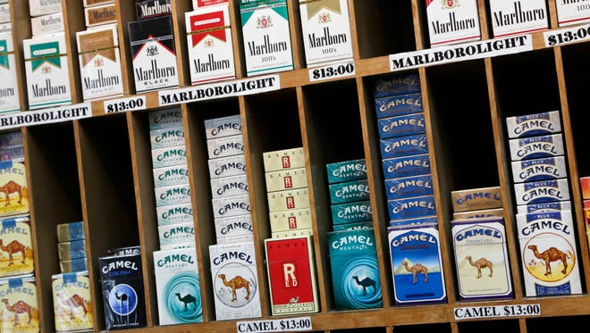 Cigarette packs are displayed for sale at a convenience store in New York City.
