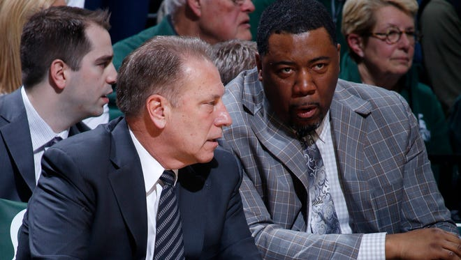 In this Feb. 14, 2016, file photo, Michigan State coach Tom Izzo, left, talks with assistant Dwayne Stephens on the bench during a game on Feb. 14, in East Lansing.