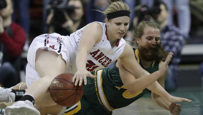 Manitowoc Lutheran High School's Abby Hiller (31) battles for a loose ball against Melrose-Mindoro High School's Calette Lockington (10) during their Division 4 semifinal game at the WIAA state girls basketball tournament Thursday, March 8, 2018, at the Resch Center in Ashwaubenon, Wis.