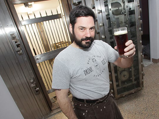 Joe Fisher raises a toast at Man Skirt Brewery.