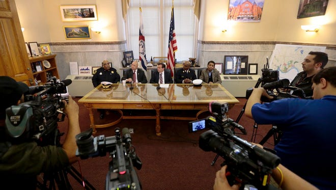 Cincinnati  Mayor John Cranley, center, takes part in a press conference at City Hall other top city leaders to discuss the mistrial in the Ray Tensing trial. Judge Megan Shanahan declared a mistrial on the third day of jury deliberations. They could not reach a verdict on either charge.