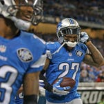 Glover Quin (27) of the Detroit Lions celebrates his interception of Drew Brees on Sunday, Oct. 19, 2014, in Detroit.
