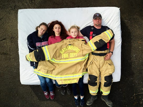 Pete Thompson and his family are photographed on a