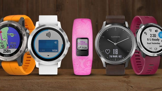 A lineup of Garmin's fitness trackers and smartwatches.