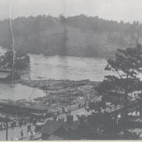Butler Bridge in Asheville was covered by the flooding of the French Broad River in July 1916.