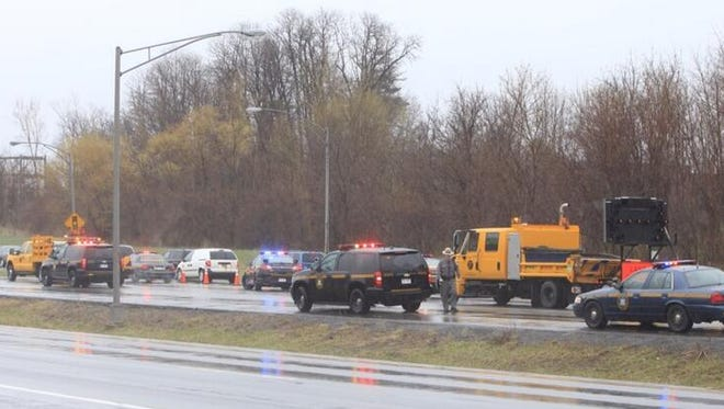 Police conduct an investigation on I-390 North at the Ridge Road Exit on Wednesday morning.