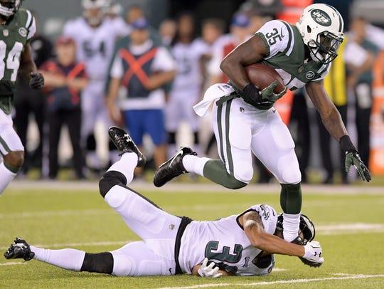 New York Jets running back Elijah McGuire (35) avoids