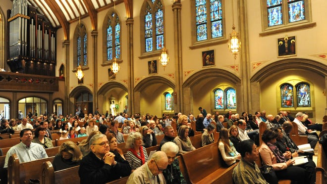 People at the Cathedral of St. John Berchmans Sunday.