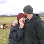 Charlie Adams comforts his mother Mary Ann Adams Sunday morning on the remains of the family farm off Daisy Hill Road in Washington County. Mary Ann and husband John Adams lost their home as well as several buildings and livestock when Friday's tornado ripped through the hilly area. (By Matt Stone, The Courier-Journal) March 4, 2012