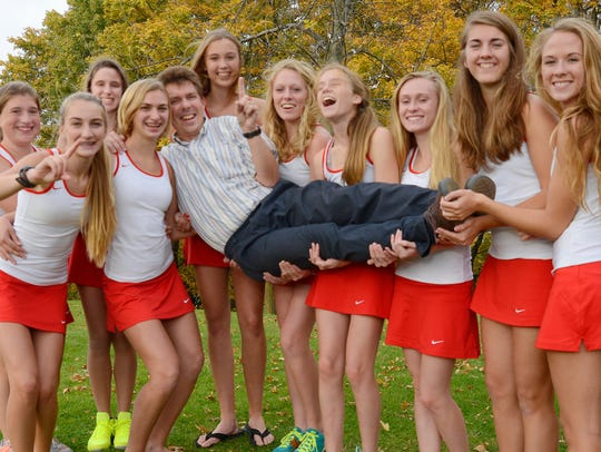 Manitowoc Lincoln girls tennis team holds up their