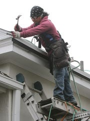 Wearing a safety harness, worker Marco Ortiz of Franzoso