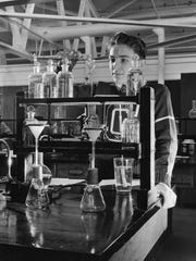 A student studies chemistry at a trade school in 1946.