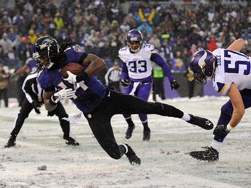 Baltimore Ravens wide receiver Marlon Brown, center, falls into the end zone after making a touchdown catch in the second half of an NFL football game against the Minnesota Vikings, Sunday, Dec. 8, 2013, in Baltimore. (AP Photo/Nick Wass) ORG XMIT: O