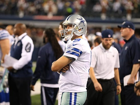 Dec 15, 2013; Arlington, TX, USA; Dallas Cowboys quarterback Tony Romo (9) reacts on the sidelines during the fourth quarter after throwing an interception against the Green Bay Packers at AT&T Stadium. The Packers beat the Cowboys 37-36. Mandatory C