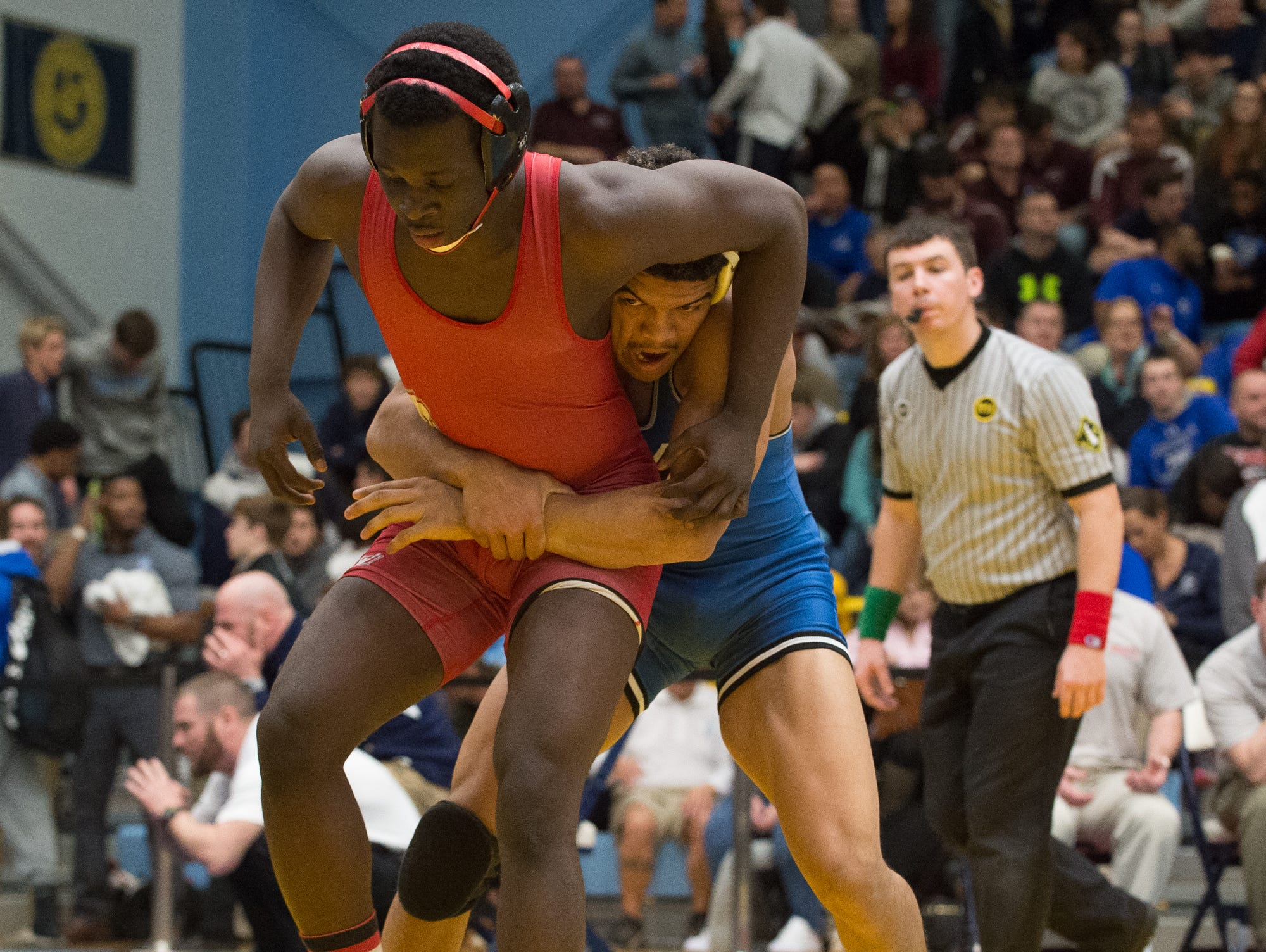 Smyrna's Larsen Wilson, left tries to get out of a hold by Middletown's Isiah Mitchell in the 170 pound quarterfinals at the DIAA Individual State Tournament at Cape Henlopen High School.