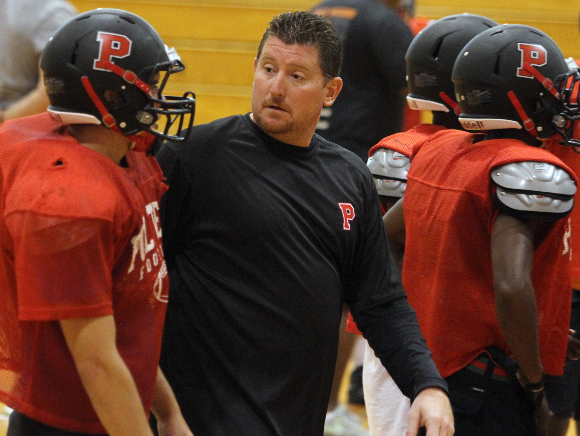 Kevin Smith guides Polytech through a preseason practice during his first stint as the Panthers' football coach in 2013. Smith will return as Polytech's coach next season.