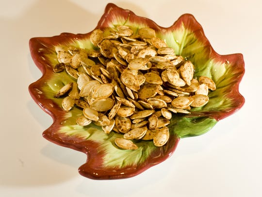 Ground cumin, chipotle powder and cinnamon put punch into roasted pumpkin seeds.