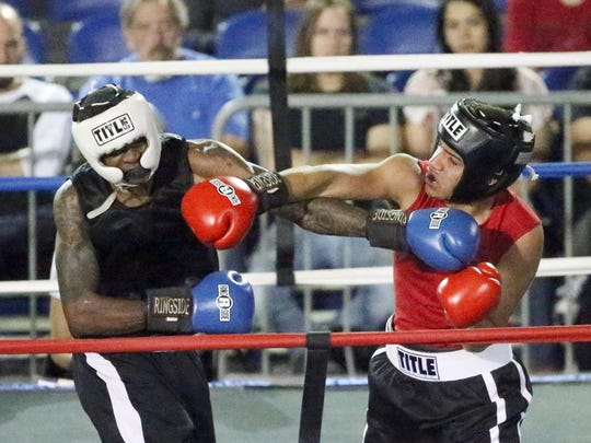 Christopher Boyd, left, and Jose Granillo box Saturday in the County Coliseum. Granillo won the bout.