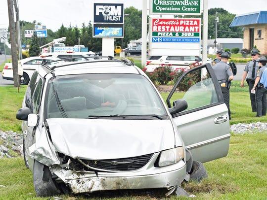 Three  passengers in a minivan were injured during