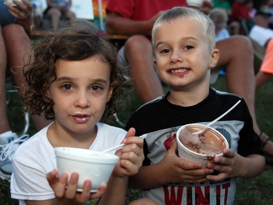 Natalie and Joey Gross, both 4 of Bel air, enjoy Sundaes in the Park at Northside Park in Ocean City in this 2013 file photo.