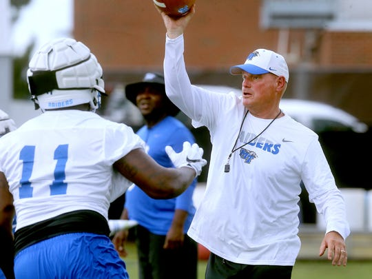 MTSU's new Defensive Coordinator/Safeties Coach Scott Shafer works with players during practice, on Tuesday, Aug. 1, 2017.