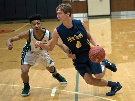 Greencastle's Brandon Stuhler (4) drives as James Buchanan's Syrus Maldonaldo defends. James Buchanan hosted Greencastle on Thursday, December 14, 2017. Blue Devils defeated Rockets 66-40.