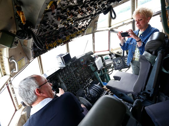 Sharon Schulz takes a photo of Brad Smith in the cockpit
