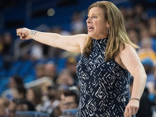 UCLA head coach Cori Close yells instructions her players during the second half of a first-round game against American in the NCAA women's college basketball tournament in Los Angeles, Saturday, March 17, 2018. (AP Photo/Kyusung Gong)