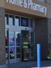 Carlsbad Fire Department firefighters clear Wal-Mart in Carlsbad after shoppers and employees were evacuated.