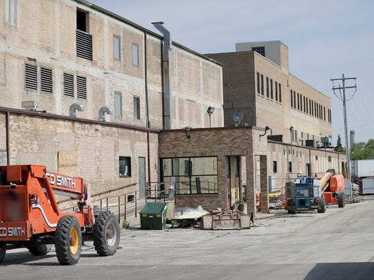 Exterior of the former Larsen Canning buildings under renovation Thursday, May 24, 2018 in Green Bay, Wis.
