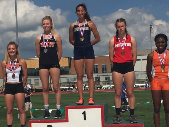 Lancaster senior Hope Purcell stands atop the podium