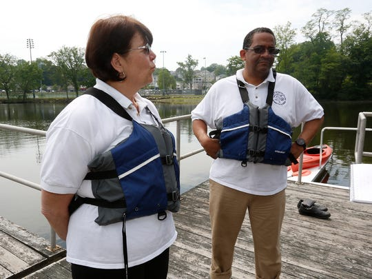 City of White Plains Dept. of Parks and Recreation Deputy Commissioner Fran Croughan and Commissioner Wayne Bass stand on the dock on Silver Lake at Liberty Park in North White Plains on Friday, May 27, 2016.